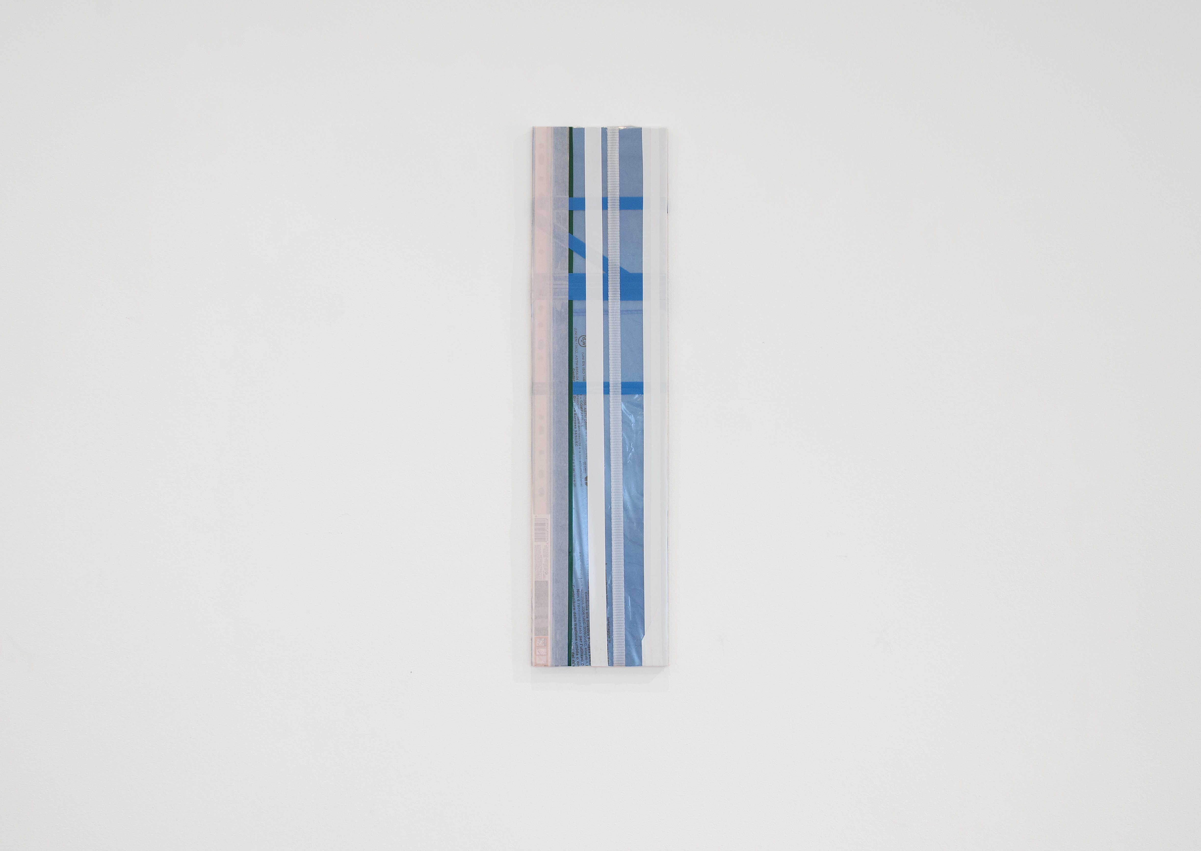 Diversions Series, 2018, Packaging strap, tape and plastics on plywood, 15×60cm